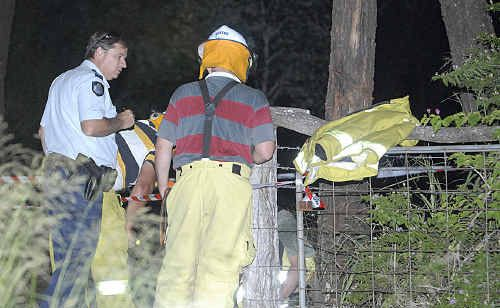 Police and emergency workers at the scene of the bomb explosion at Snelling Rd, Helidon Spa.