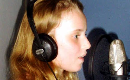 Georgie Groth records The Flood Song at MicahBaquie's Laidley studio.