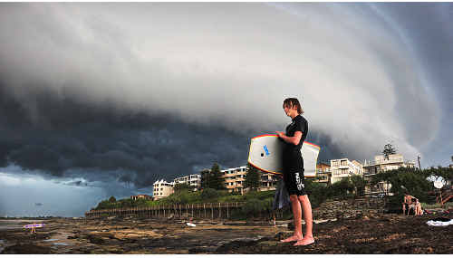 CLOSING IN: A storm front moves over Happy Valley at Caloundra to bring an end to a stiflingly hot day.