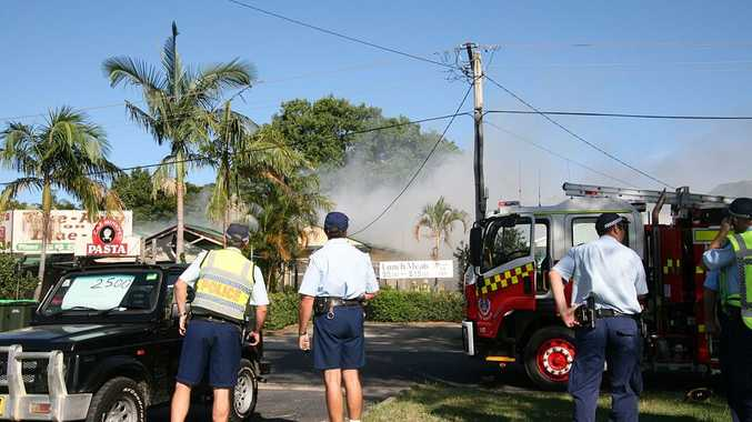 UP IN SMOKE: Emergency crews at the scene of Sunday evening's fire in Rose Avenue.