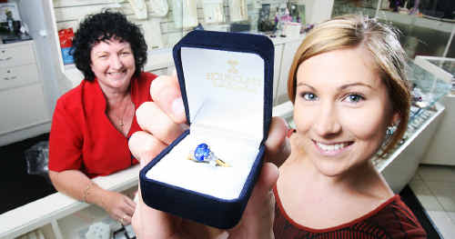 Sam Kunde checks out a sapphire ring which is becoming popular among Ipswich women. Booval Hourglass Jewellers assistant manager Yvonne Otto looks on.