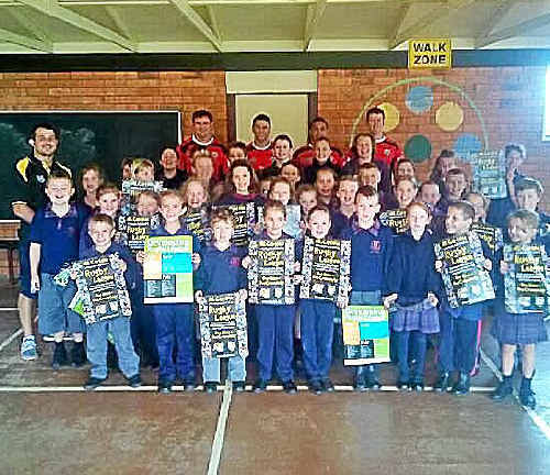 Australian Army Thunder league players were mobbed by the kids at Mount St John Infants School in Dorrrigo.