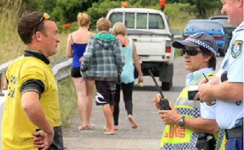 Police talk to eye witnesses after an accident at Sleepy Hollow.