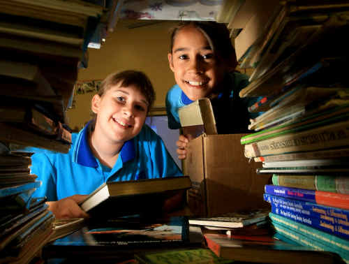 Amanda Castle and Phyllis Billin are sending books to flood victims.
