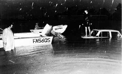 Residents took to boats and climbed on car bonnets as the 1974 floods hit the Ipswich region.