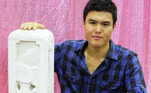 Young artist Andrew Truong with his sculpture God's Creation at the Lockyer Valley art festival.