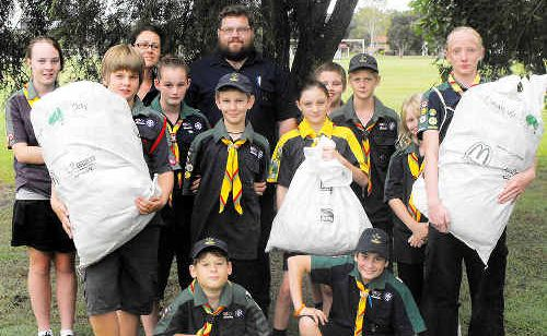 Scouts leader Matthew Needham (centre back) is pictured with 2nd Casino Scouts Group members who will be cleaning up around the Casino boat ramp at McDonalds Park during Clean up Australia Day on March 6.