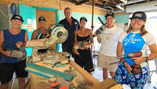 Crew foreman Paul Guillespie and local volunteers Jan Gielis, Karen Powell, Felicity Maitze, Susan Young and Joanne Colja renovate the Cudgen Headland Surf Life Saving Club.