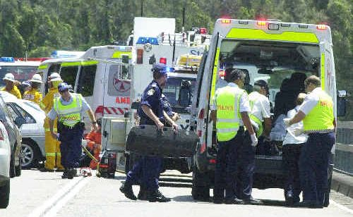 Paramedics at the scene of an accident on the Pacific Highway.