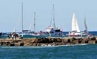 Jessica Watson rounds Point Cartwright on her return to Mooloolaba aboard her yacht Ella's Pink Lady after her around-the-world voyage.