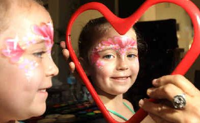 Four-year-old Makayla Wilkins gets her face painted at the Domain open day at Tweed Heads.
