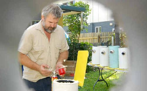 Volunteer Mike Griinke puts foam in one of the nest boxes.