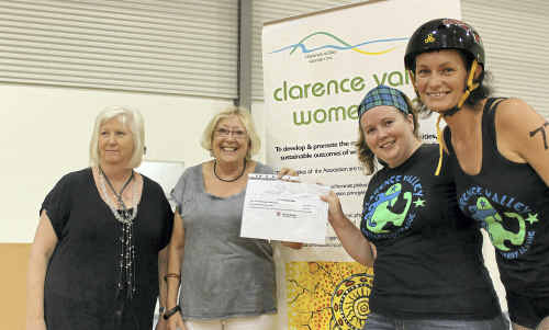 Clarence Valley Women treasurer Vicki St Lawrence and president Susan Howland and Clarence Valley Roller Derby League treasurer Belinda Head and president Jade Simpson after the grant.