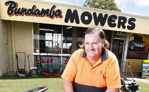 Bundamba Mower and Chainsaw Repairs and Service owner Tony Burn outside his shop on Mining Street.