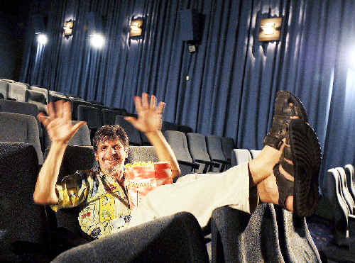 Filmmaker Darmin Cameron, of Billen Cliffs, will have his film Interpreting Woodford screened at the Byron Bay Film Festival. He is pictured signing the AUSLAN for applause.