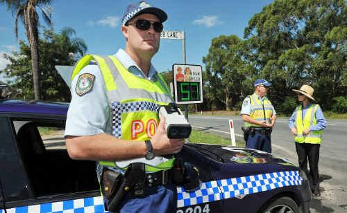 Senior Constable Adam Williams checks speeds along Hogbin Dr with Sergeant Brett Jackson and Anne Shearer from the Coffs City Council.