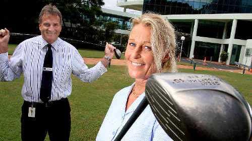 JOINING FORCES: John Flynn Hospital CEO Greg Jenke with golf day organiser Sally Williams.