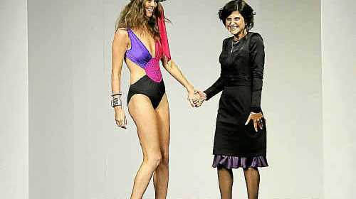 DIVE IN: Joanne Rahn (right) on the catwalk with a model at the Mercedes Benz Fashion Festival in Brisbane