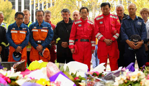 AFTERSHOCK: Emergency workers pay tribute at a ceremony in Christchurch for victims of the earthquake. AAP images