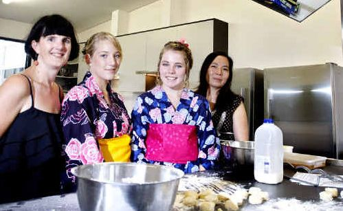 From left, Teacher Tamasine Collins, year 11 Japanese students Marijke Vaughan and Katie Graham and teacher Angela Teramoto at Ipswich State High School's Asian Learning Centre.