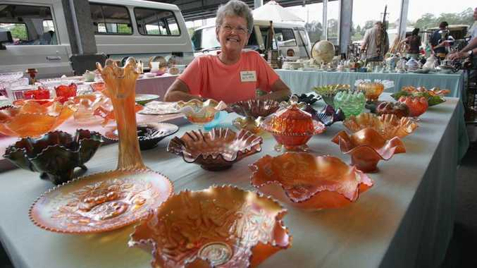 Wilma Berry with her collection of carnival glass at the Collectorama fair at Nambour.