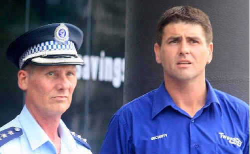 Tweed Heads Police Inspector Greg Jago and a Tweed City Shopping Centre security guard ensure the safety of shoppers.
