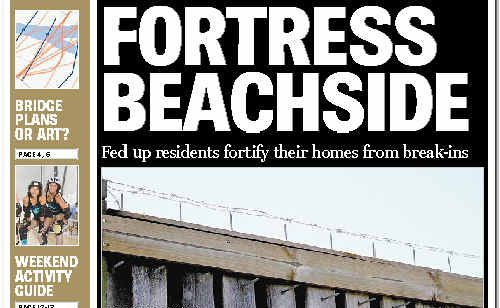 The Daily Examiner's front page on Saturday showing barbed wire on top of a wall surrounding Beachside apartments.