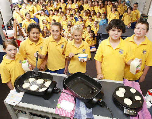 St Carthage's Year 6 students (from left) Meghann Rice-Finlayson, Sophie Hurtis, Gabriella McDonald, Daniel War, Ethan Griffiths and Alexander Tooth cooking pancakes yesterday while they and their classmates learn about Shrove Tuesday, the last day before the start of Lent.