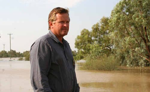 The Australian Agricultural College Corporation's new CEO Tony Rayner overlooks some inundated land during the recent flood crisis.