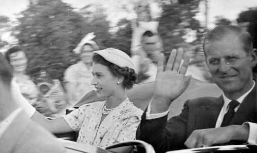 Queen Elizabeth II and Prince Philip, the Duke of Edinburgh, waving to Rockhampton residents as they drove along Bolsover Street on their 1954 visit to Rockhampton.
