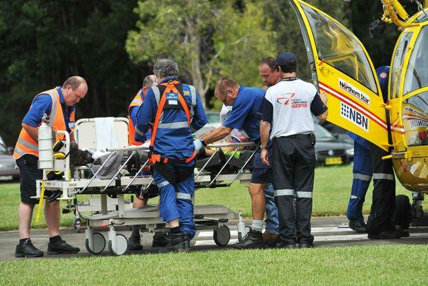 Rescuers prepare a patient for transport