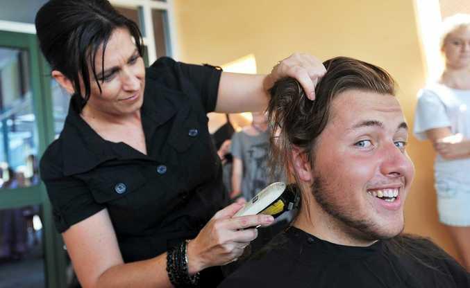 Nat Sherwood loses his locks to hairdresser Beth Ryan. Photo Bruce Thomas