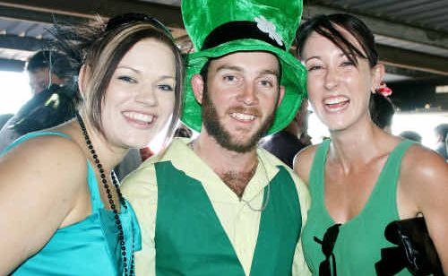Amanda Newman, Aarron and Nicole Johnson dress up for St Patrick's Day by the track.