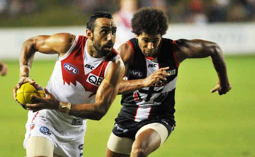 Sydney Swans captain Adam Goodes (L).