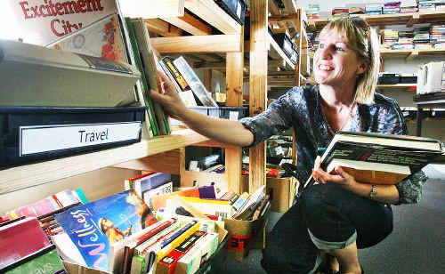Carolyn Symonds sorts through the thousands of books that were available at the Ipswich Hospice Book Fest. Photo: Rob Williams