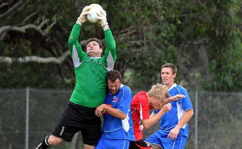 Local Soccer (Football) match at Caloundra. Cooroora goal keeper Dylan Graham makes a save against Caloundra.