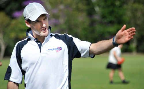 AFL umpire Matt Stevic shows the way to students at Bishop Druitt College yesterday.