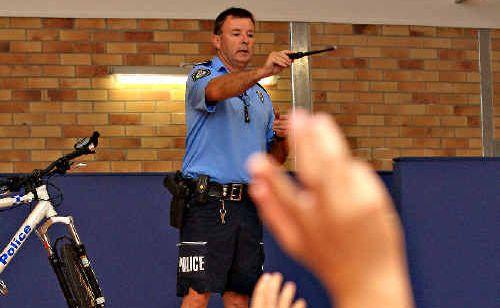 Tweed police crime co-ordinator Sergeant Stuart Crawford talks to students at Tweed Heads Public School.