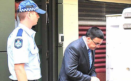 LIFE SENTENCE: Richard Giardina is led from the Maryborough courthouse yesterday. Photo: Nat Bromhead / Fraser Coast Chronicle