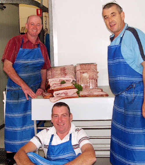 Mick Metcalf (left), Doug Flick and Mick Caspen with some of the national award-winning bacon.