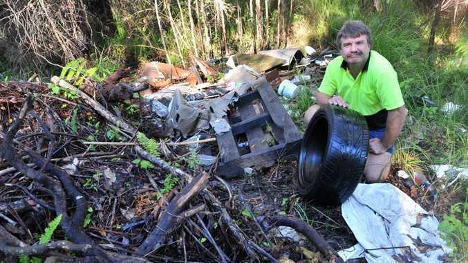 Clean Up Australia Day Noosa Region coordinator Joe Jurisevic with an illegal dump site in Noosa.