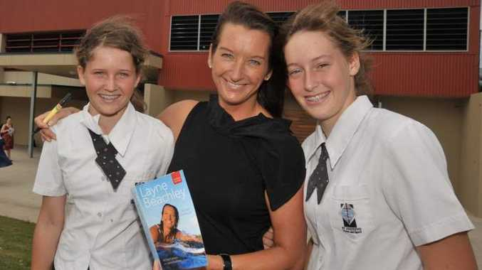 Seven-times world surfing champion, Layne Beachley, visited St Andrew's Anglican College at Peregian Springs Layne is pictured with students Elyse, 12, left, and Jacinta Ainsworth, 13, who have made the Queensland State sailing team. Photo: Brett Wortman/Sunshine Coast Daily