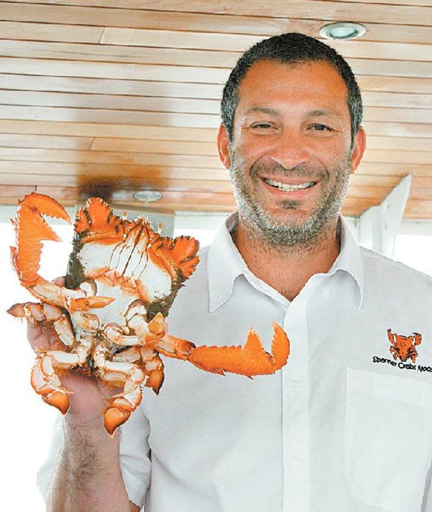 Spanner Crabs Noosa owner Jason Sgro with one of his favourite critters.