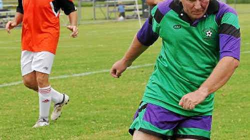 FANCY FEET: Misfits' Michael Woodward shows his footwork at the Supa Oldie Soccer annual Grafton Cup at Rushforth Park, South Grafton. Photos: DEBRAH NOVAK