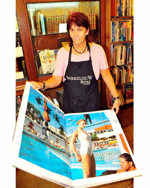 Berkelouw Books Eumundi manager Amanda Isler with Helmet Newton's 30kg book that sold to a collector for $7000.