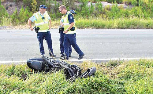Police try to determine what caused the the crash that claimed the lives of two motorcyclists on the Bruce Highway.