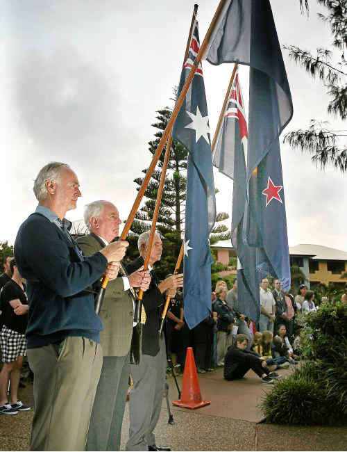 Flag bearers Warren Holloway, John O'Callaghan and Con Chatham at the Bargara Anzac Day Ceremony last year.