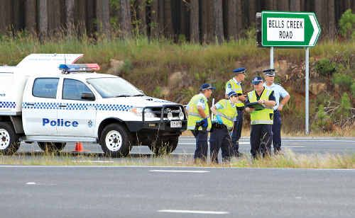 Police try to piece together what caused the crash that claimed the lives of two motorcyclists at the intersection of Bells Creek Road and the Bruce Highway.
