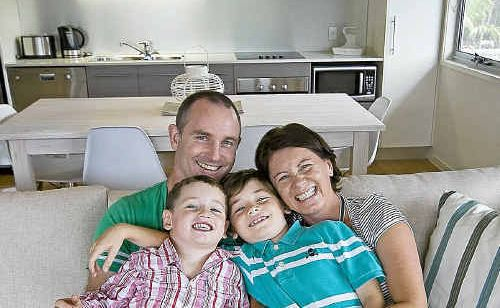 Brisbane family Sophie and David Griffiths with their sons Huw, 4, and Max, 7, happy in their Casuarina Beach Shack.