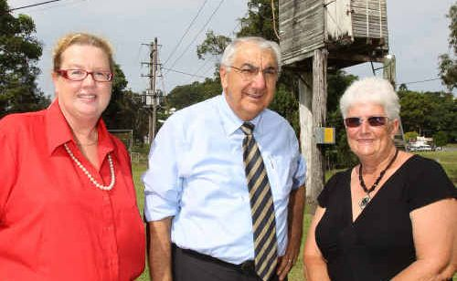 Show Society secretary Liz Chauvier with Lismore MP Thomas George and society president Jenny Glasby in front of the old electrical box.